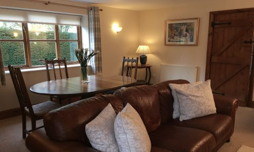 Sitting Room with Dining Table, Corner Cottage, Broadway Manor Cottages, Cotswold holiday cottages in Broadway