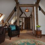 Rafters vaulted sitting dining room Cotswold holiday apartment