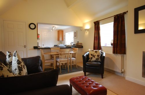 The Stables, vaulted sitting and dining room, Broadway Manor Cottages Cotswold accommodation
